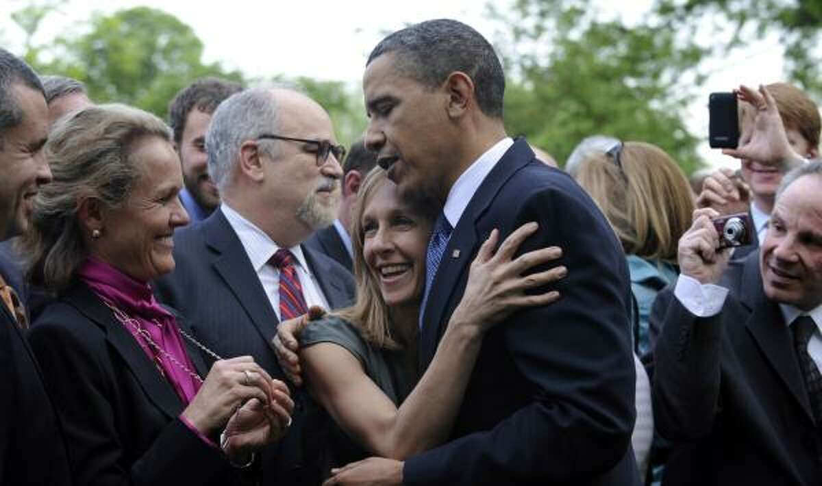 President Barack Obama greets the crowd at an Earth Day reception in the Rose Garden.
