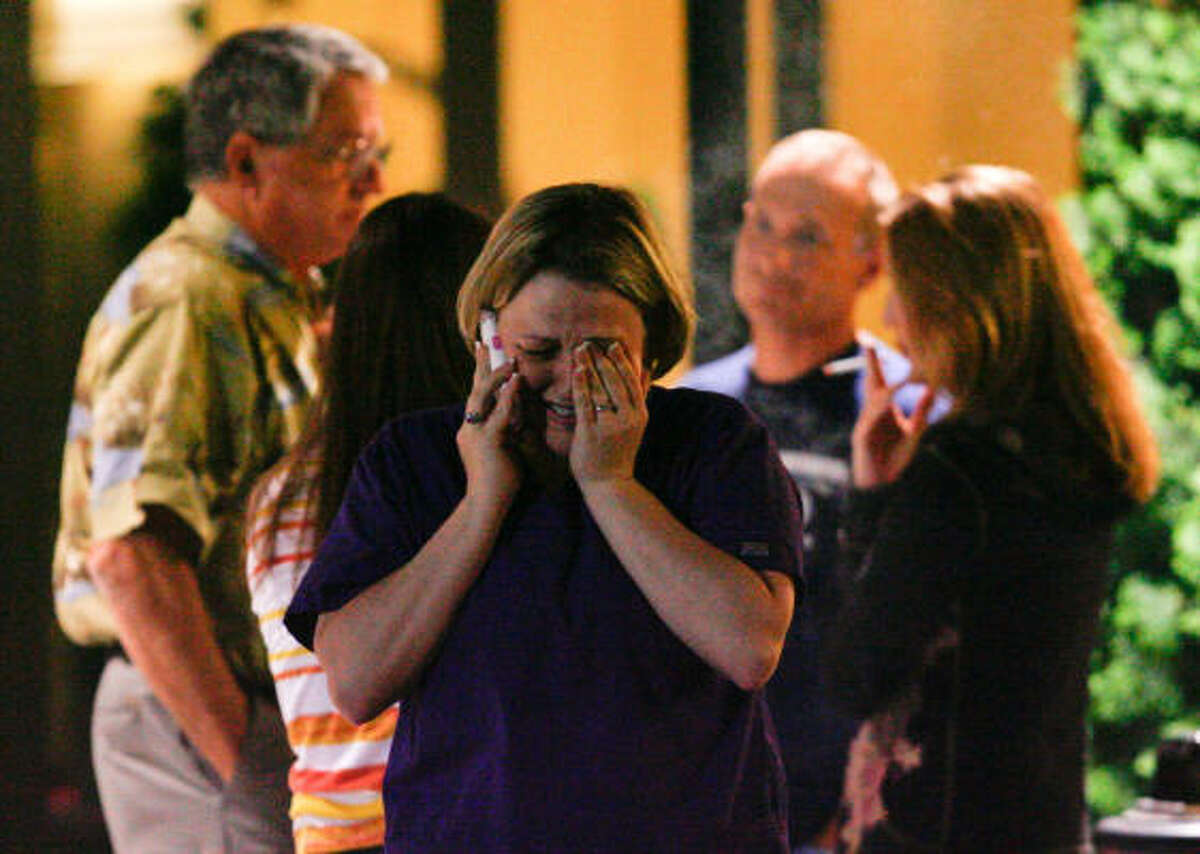 Kristy Murray gets emotional at the Crowne Plaza hotel early Thursday,morning April 22, 2010 while she talking on the phone as hope dwindles for a family friend still missing from the explosion. Murray was reunited Thursday morning with her brother Chad Murray the chief electrician for Transocean Corp, who survived the explosion of the Deepwater Horizon oil rig. (