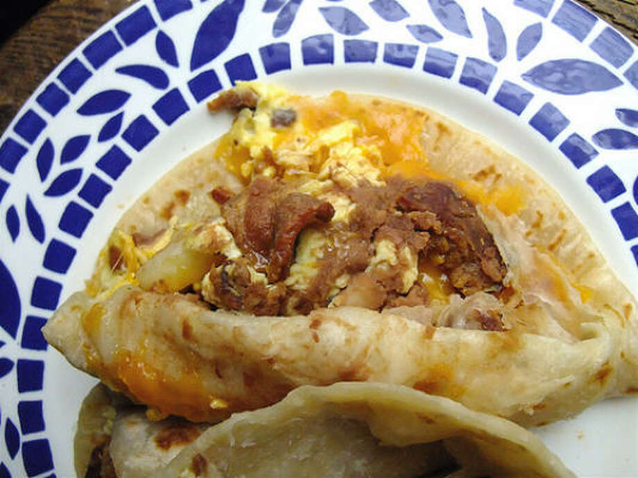 Breakfast tacos on the other hand are straight up Texas. Especially bean and cheese. Oh yes, one more thing. If you go to an eatery and order a bean and cheese or any breakfast taco and are told they only serve them in the morning. Leave that place. Leave and never go back. Restaurants like that should not even be allowed to operate in Texas. Photo: Alison Cook, Chronicle