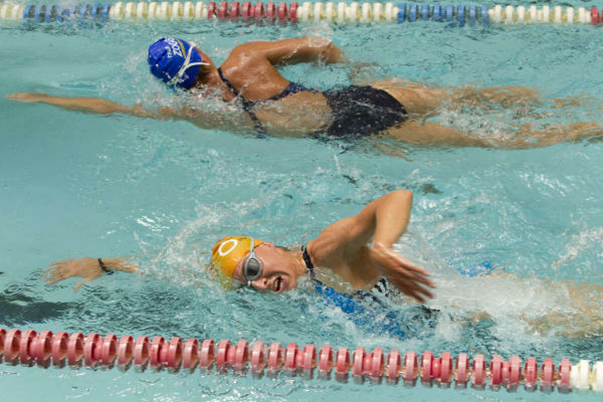 German triathletes Anne Haug, bottom, and Anja Knapp swim laps as they work out with their team at the Lake Houston Family YMCA Wednesday, April 21, 2010, in Kingwood. The triathlon team is stranded in Houston due to the volcanic ash from Iceland.