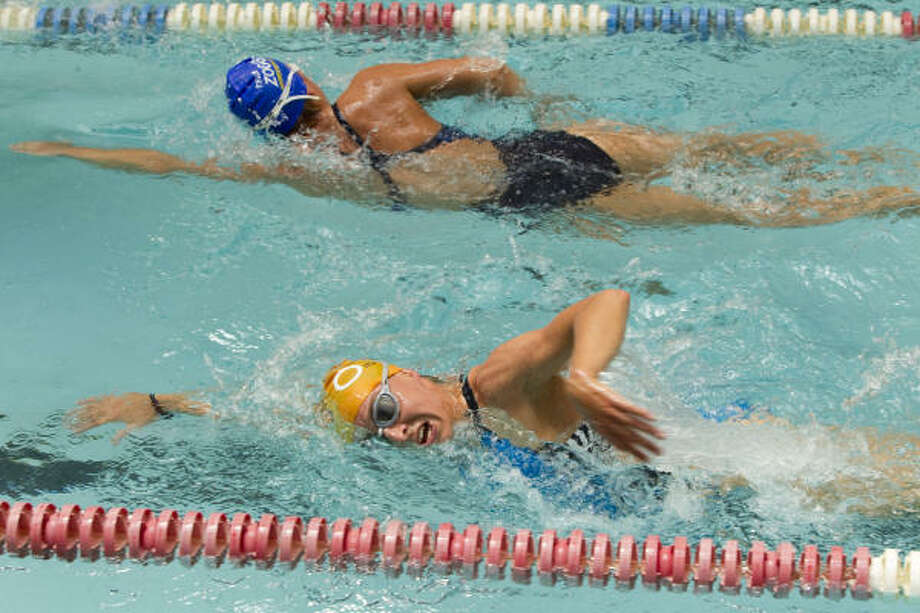 German triathletes Anne Haug, bottom, and Anja Knapp swim laps as they work out with their team at the Lake Houston Family YMCA Wednesday, April 21, 2010, in Kingwood. The triathlon team is stranded in Houston due to the volcanic ash from Iceland. Photo: Brett Coomer, Chronicle