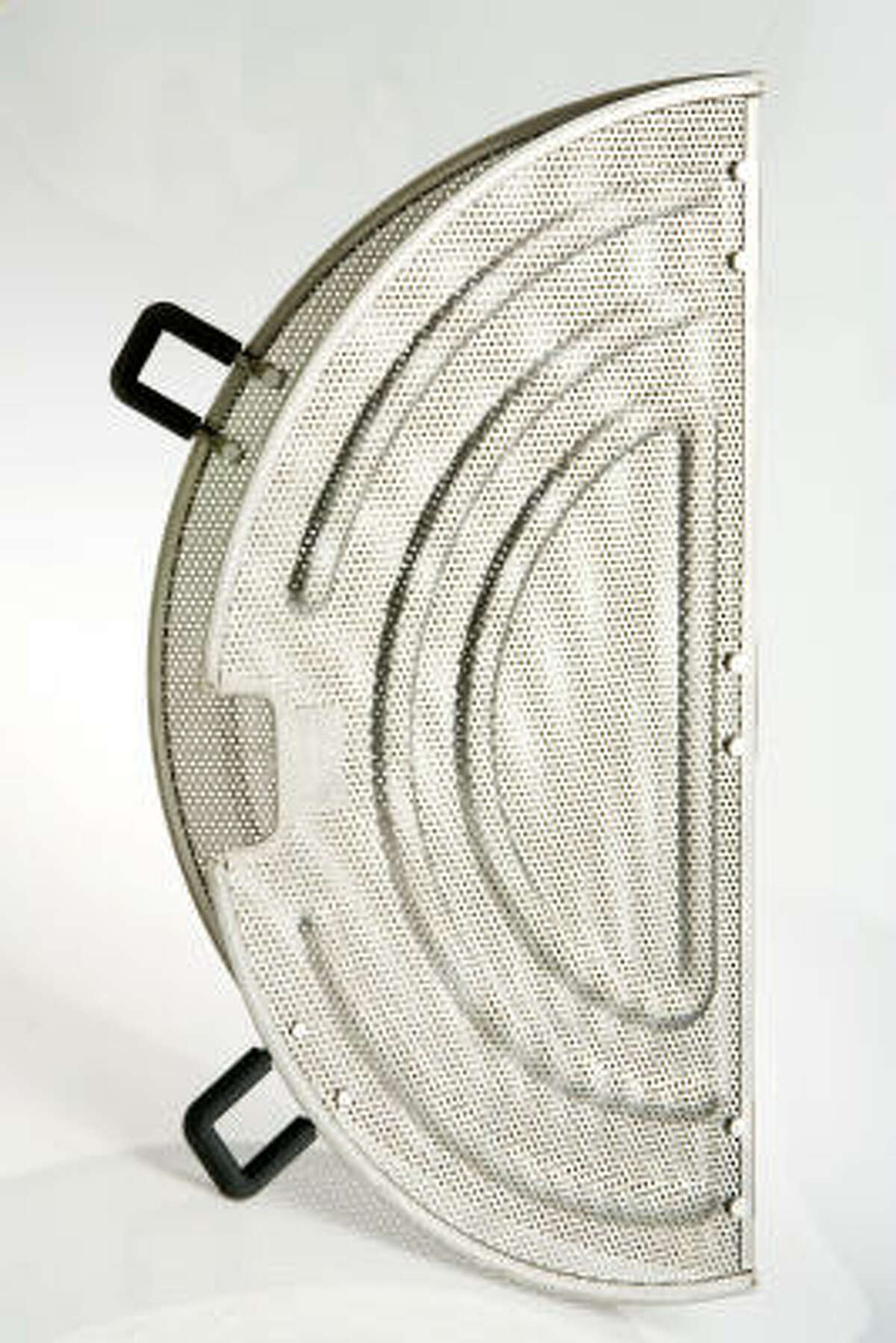 The hinged middle and silicone handles of this stainless-steel splatter screen from The Pampered Chef allow cooks to lift it partway during frying.