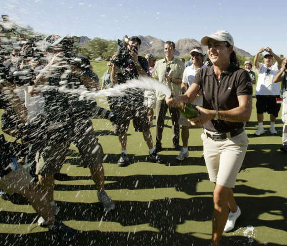 Ochoa celebrates her victory in the LPGA Samsung Championship by spraying champagne on fans in Palm Desert, Calif., on Oct. 17, 2007. Photo: Reed Saxon, AP