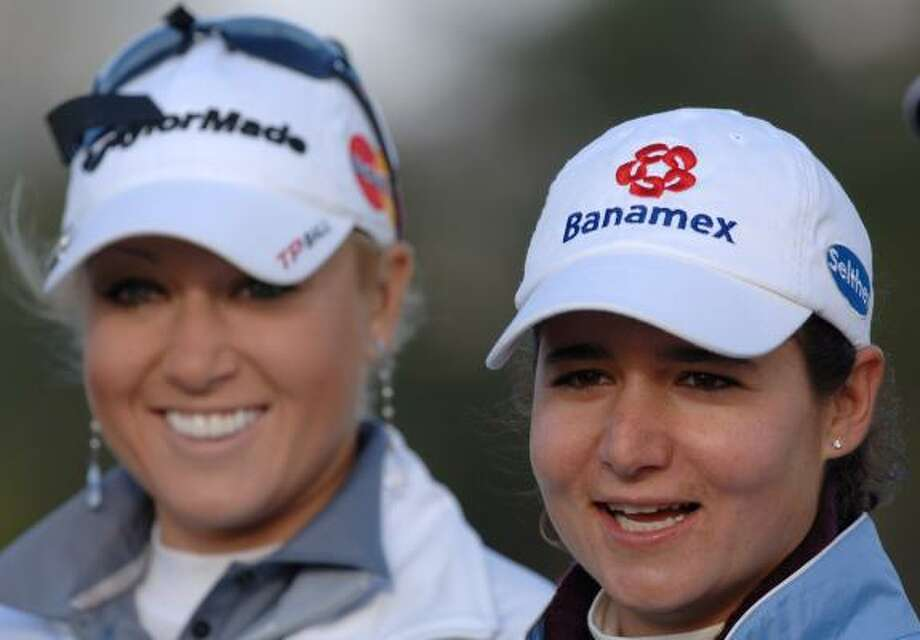 Natalie Gulbis, left, and Lorena Ochoa share a laugh before the start of the Annika Celebration golf skins game in Reunion, Fla., on Feb. 3, 2009. Photo: Phelan M. Ebenhack, AP