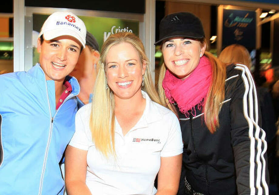 Lorena Ochoa, left, poses with fellow tour players Brittany Lincicome and Paula Creamer at the 2009 PGA Merchandise Show at the Orange County Convertion Center on Jan. 30, 2009 in Orlando, Fla. Photo: Scott Halleran, Getty Images