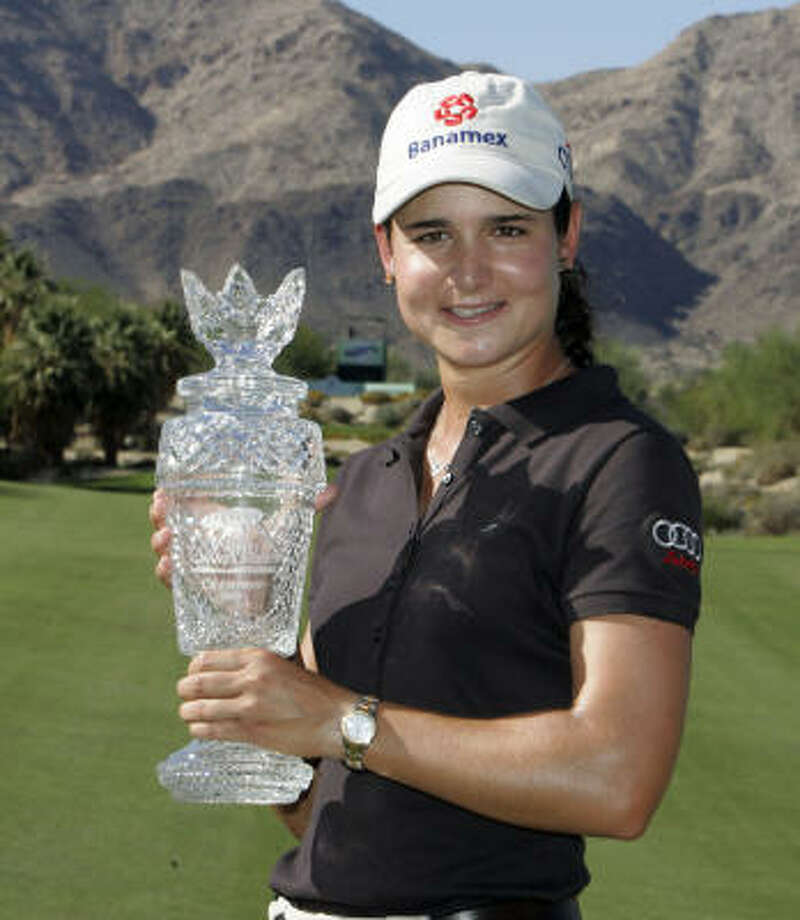 Ochoa with the winner's trophy after her victory in the LPGA Samsung Championship in Palm Desert, Calif., Oct. 14, 2007. Photo: Reed Saxon, AP