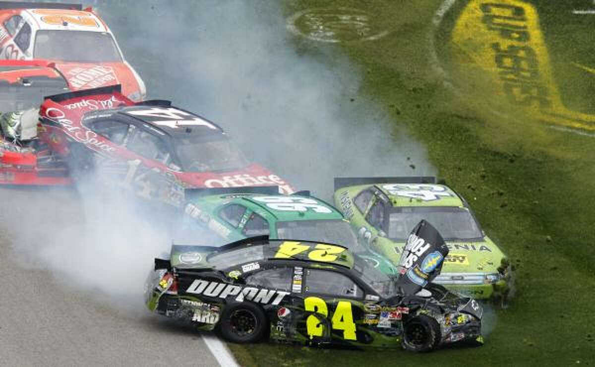 Jeff Gordon (24), Carl Edwards (99), AJ Allmendinger (43), Tony Stewart (14) Jamie McMurray (1) and Joey Logano (20) wreck during the NASCAR Sprint Cup Series' Samsung Mobile 500.