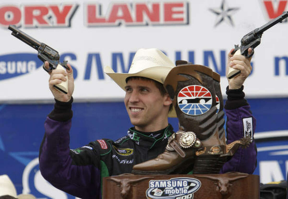 Denny Hamlin celebrates winning the Samsung Mobile 500 auto race at Texas Motor Speedway in Fort Worth.