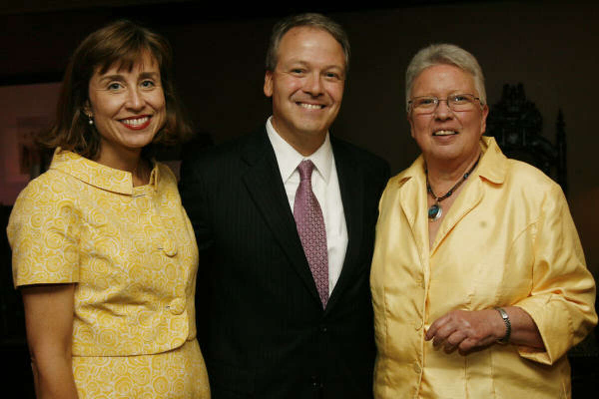 Dr. Julie Boom, Dr.Marc Boom and Mary Jo May