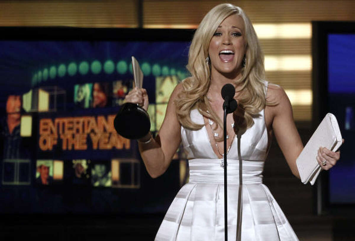 Carrie Underwood accepts the award for Entertainer of the Year at the 45th Annual Academy of Country Music Awards.