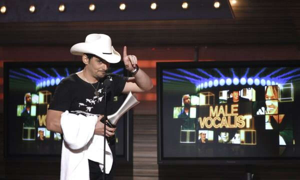 Brad Paisley accepts the award for top male vocalist.
