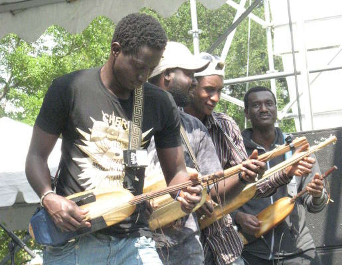 Bassekou Kouyate, right, a musician from Mali, and his group Ngoni Ba