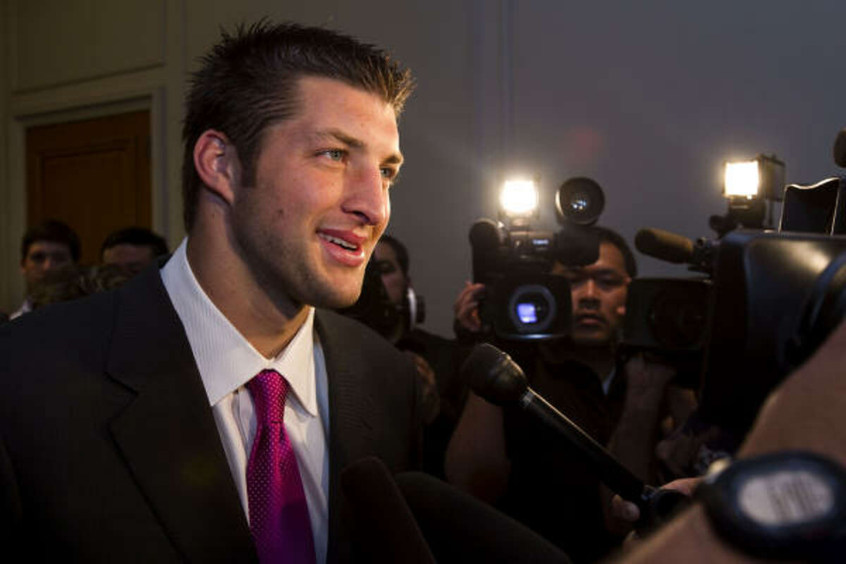 Tim Tebow speaks in front of cameras while signing autographs at the Westin Galleria.