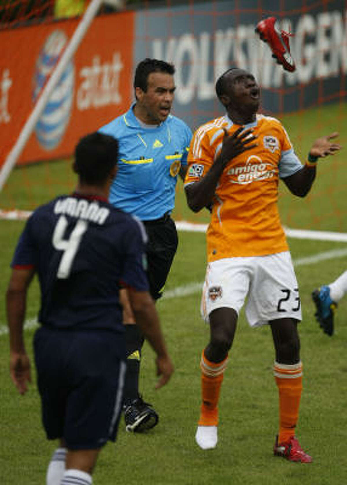 Dynamo forward Dominic Oduro celebrates his goal by juggling his shoe after scoring the final goal.