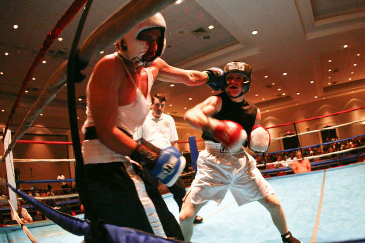 Beau Osborne, right, lands a punch against Lalo Limones. Osborne went on to win their 130-pound bout.