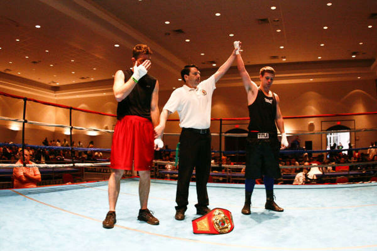 Nicholas Howe, right, is announced as the winner after his 175-pound fight against Dustin Bass.