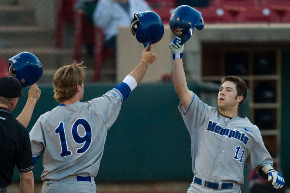 Memphis' Rick Russel (19) celebrates with Phillip Chapman (11) after Chapman hit a home run off UH pitcher Taylor Hammack during the fourth inning.