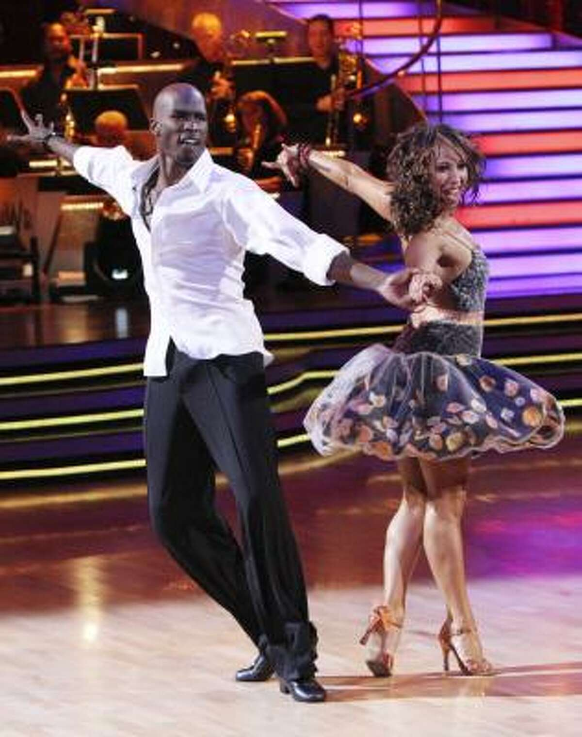 """In this publicity image released by ABC, NFL player Chad Ochocinco, left, and his partner Cheryl Burke perform on the celebrity dance competition series, """"Dancing With the Stars,"""" Monday, March 22, 2010 in Los Angeles."""