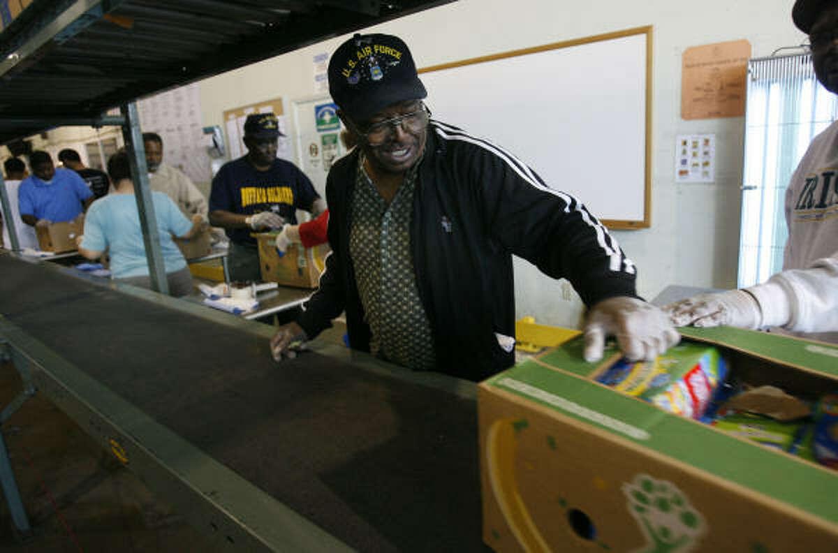 Robert Alfred, of Galveston, volunteers in the food line as part of the Feeding America's local food bank.