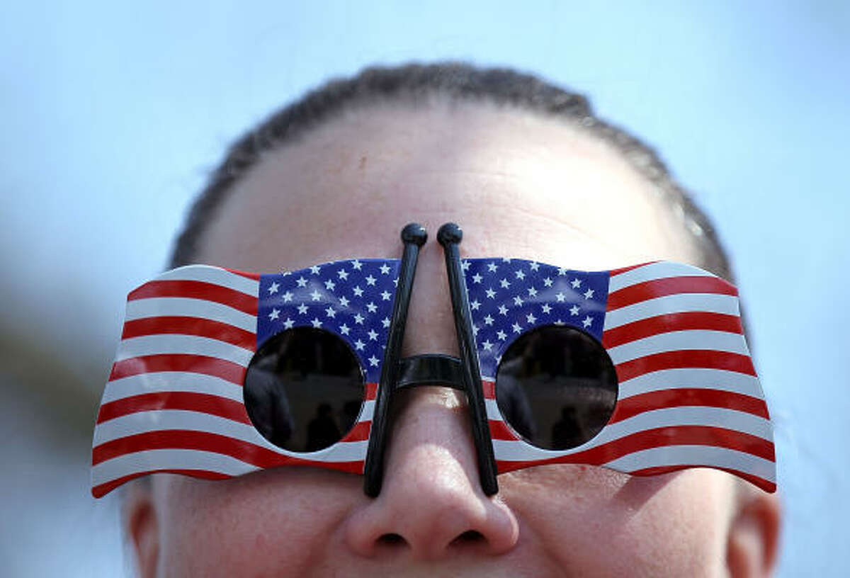 Linda Lovelock wears American flag sunglasses during the 2010 Tax Day Tea Party in Pleasanton, California.