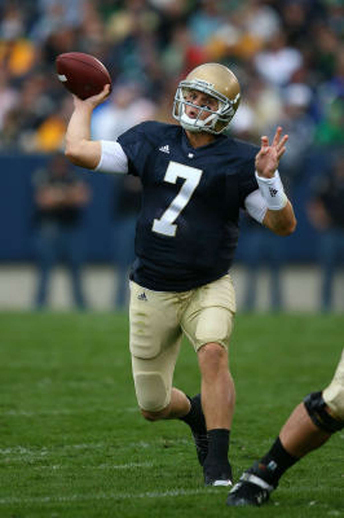 Jimmy Clausen, 6-2 1⁄5, 222, 4.73, Notre Dame Some scouts think this underclassman could have a free fall in the first round like Aaron Rodgers, who was drafted by Green Bay and is now one of the league's best quarterbacks. There are questions about Clausen's cockiness, meaning some see him as self-centered and egotistical. Others see him as a confident leader. He's tried to shoot down those negative evaluations. He learned a lot under Charlie Weis at Notre Dame. He has good mechanics. He needs to improve accuracy on sideline routes. He throws a soft deep ball. He moves well, too. Should go in the first round.