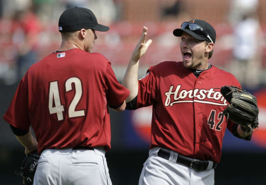 April 15: Astros 5, Cardinals 1 Matt Lindstrom, left, and Chris Johnson celebrate the Astros' 5-1 victory over the St. Louis Cardinals to snap an eight-game losing streak to open the season. Photo: Jeff Roberson, AP