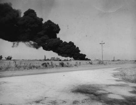 April 16, 1947: Burning tank in the distance.Read more: Newly discovered photos show extent of destruction Photo: Story Sloane Jr.