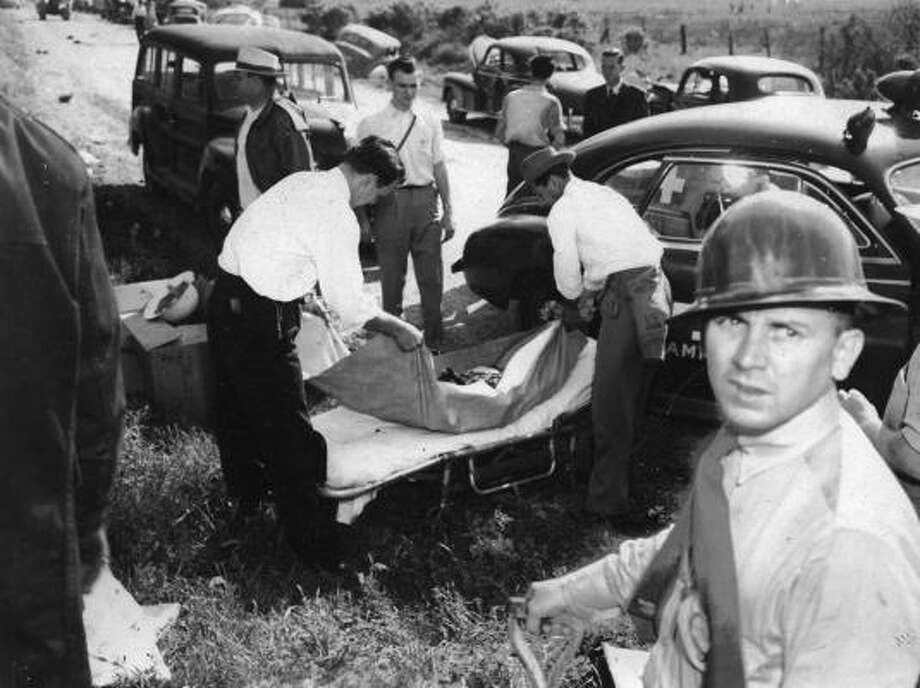 April 16, 1947: Body carried away from disaster scene.Read more: Newly discovered photos show extent of destruction Photo: Story Sloane Jr.