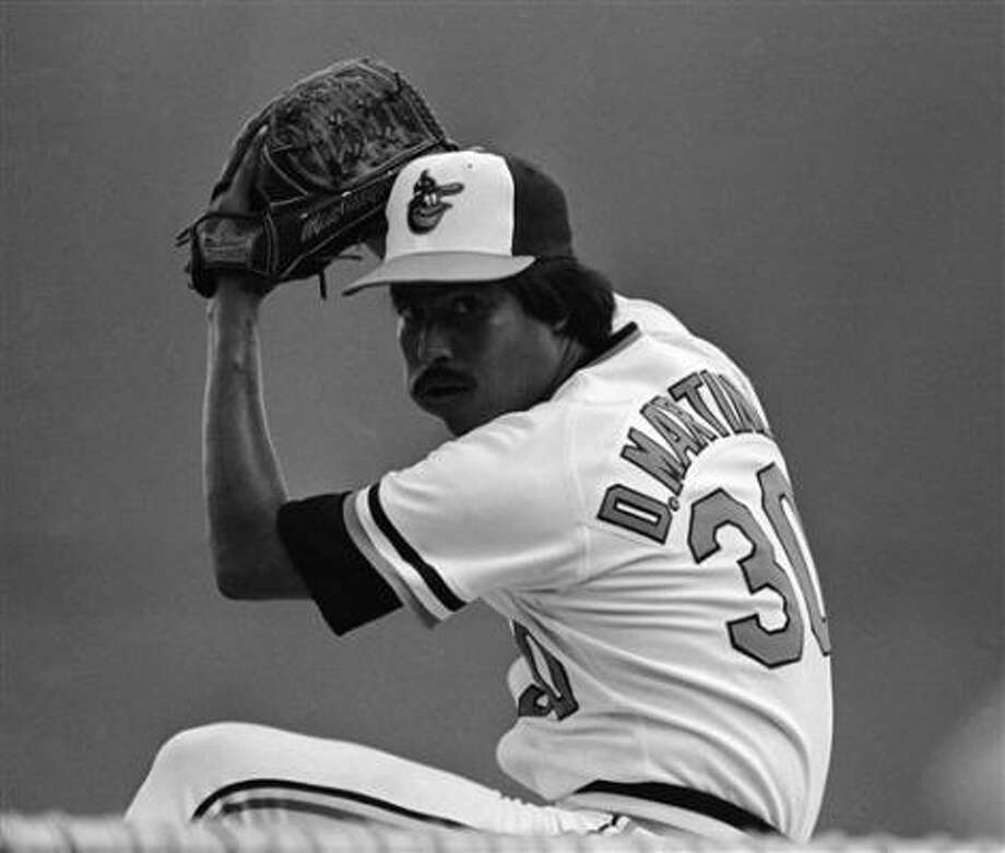 Pitcher Dennis Martinez could still deal with tobacco in his cheek. Photo: Kathy Willens, AP
