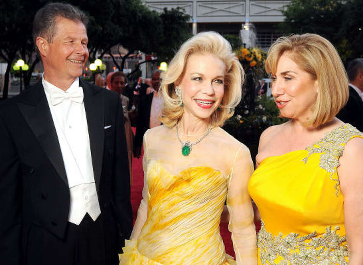 Lynn Wyatt, the honoree of the Yellow Rose Ball benefiting Houston Grand Opera, is flanked by co-chairs Philip and Denise Bahr.