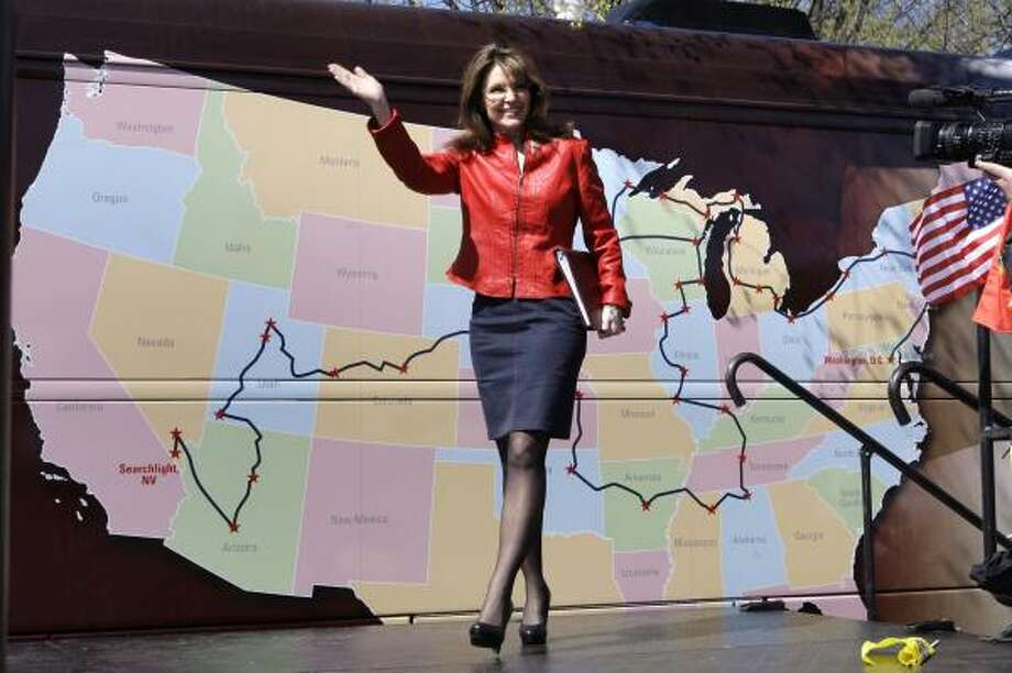 Sarah Palin waves to a crowd as she passes a road map of the Tea Party Express, prior to her address on Boston Common in Boston. Photo: Charles Krupa, AP