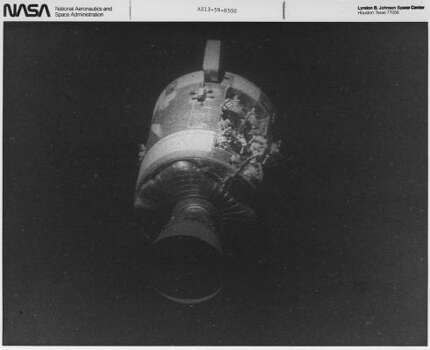 This view of the severely damaged Apollo 13 Service Module was photographed from the Lunar Module/Command Module following SM jettisoning. As seen here, an entire panel on the SM was blown away by the apparent explosion of oxygen tank number two located in Sector 4 of the SM. Two of the tree fuel cells are visible just forward (above) the heavily damaged area. Photo: NASA
