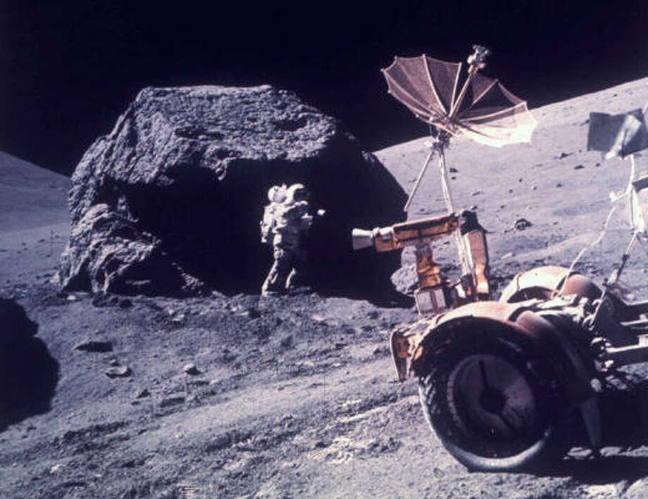 Astronaut Harrison H. Schmitt works beside a huge boulder during the third Apollo 17 extravehicular activity on the moon, Dec. 13, 1972. Photo: AP File