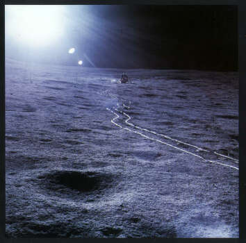 Tracks made by alien earthmen gleam in harsh sunlight in this photo by Alan Shepard during the Apollo 14 moon mission in 1971. Photo: NASA, Knopf File