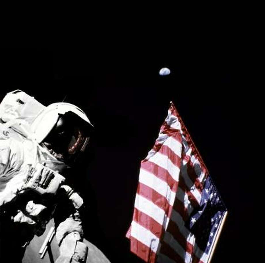 "Astronaut Harrison Schmitt poses in 1972 with Earth in the lunar sky. Schmitt later was a U.S. Senator. In 1984, he said the nation needed a ""mission control"" to deal with major emergencies such as terrorism. Photo: EUGENE CERNAN, KRT File"