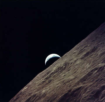 Earth rises over the moon, as captured from the lunar surface with the cameras of the Apollo 17 astronauts. Photo: NASA File