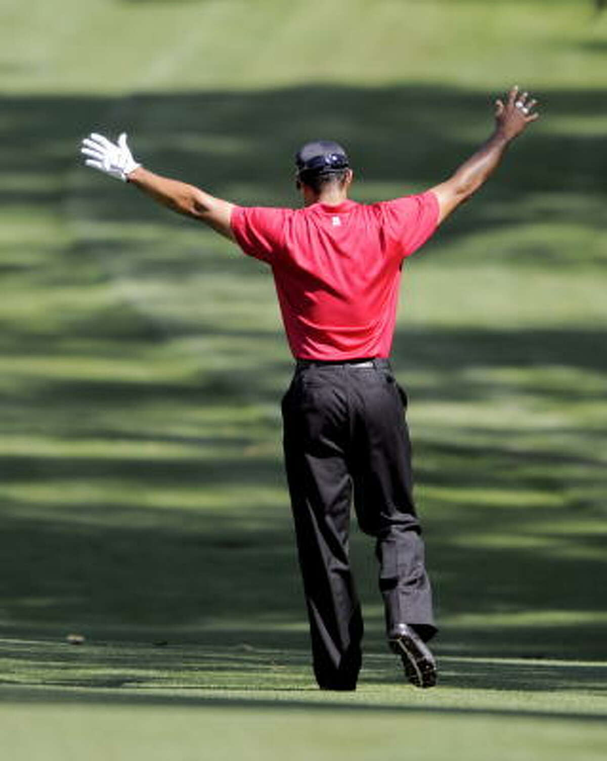 Tiger Woods celebrates eagle on the seventh hole during the final round.