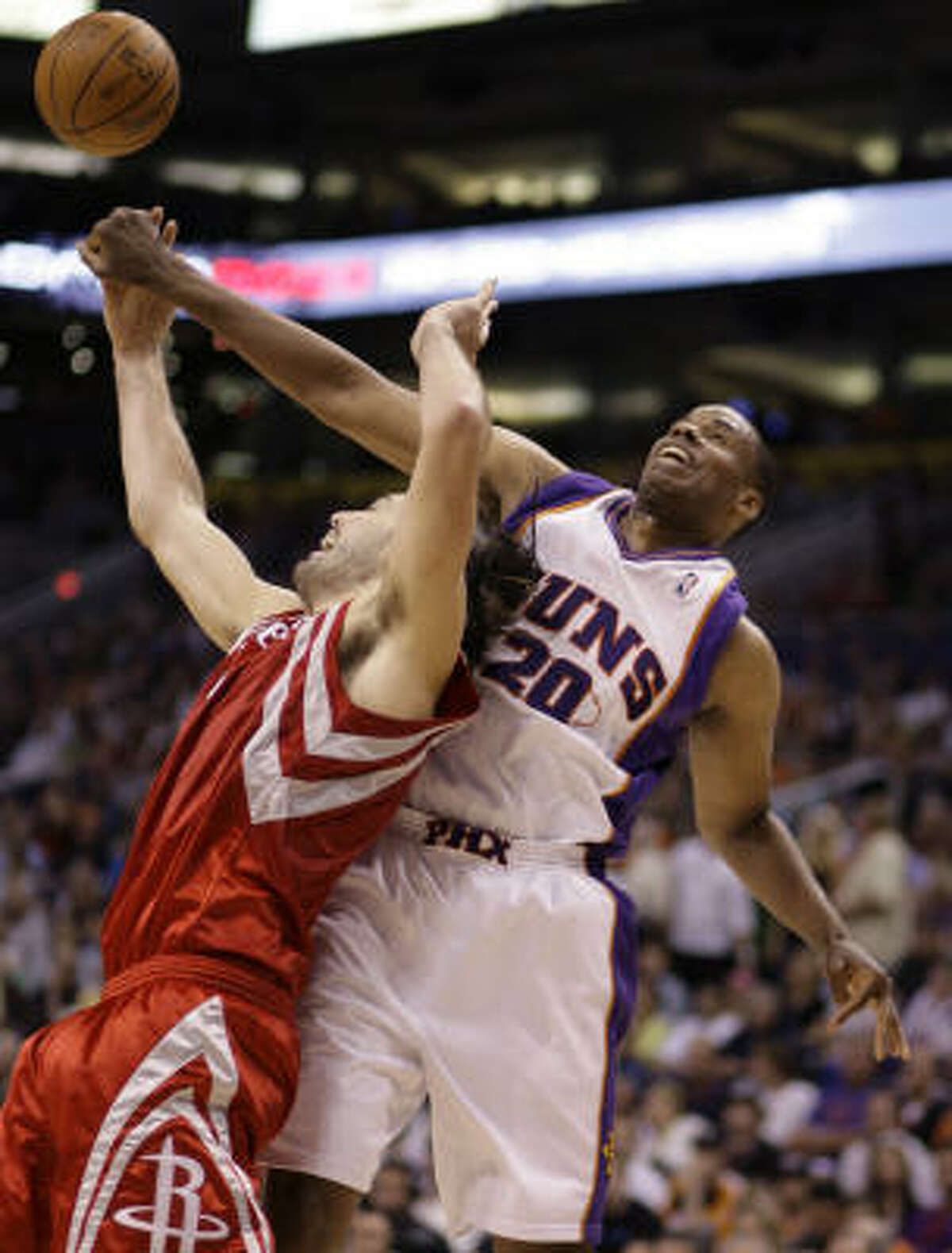 Rockets forward Luis Scola, left, and Phoenix Suns center Jarron Collins struggle to gain control of a loose ball in the third quarter.