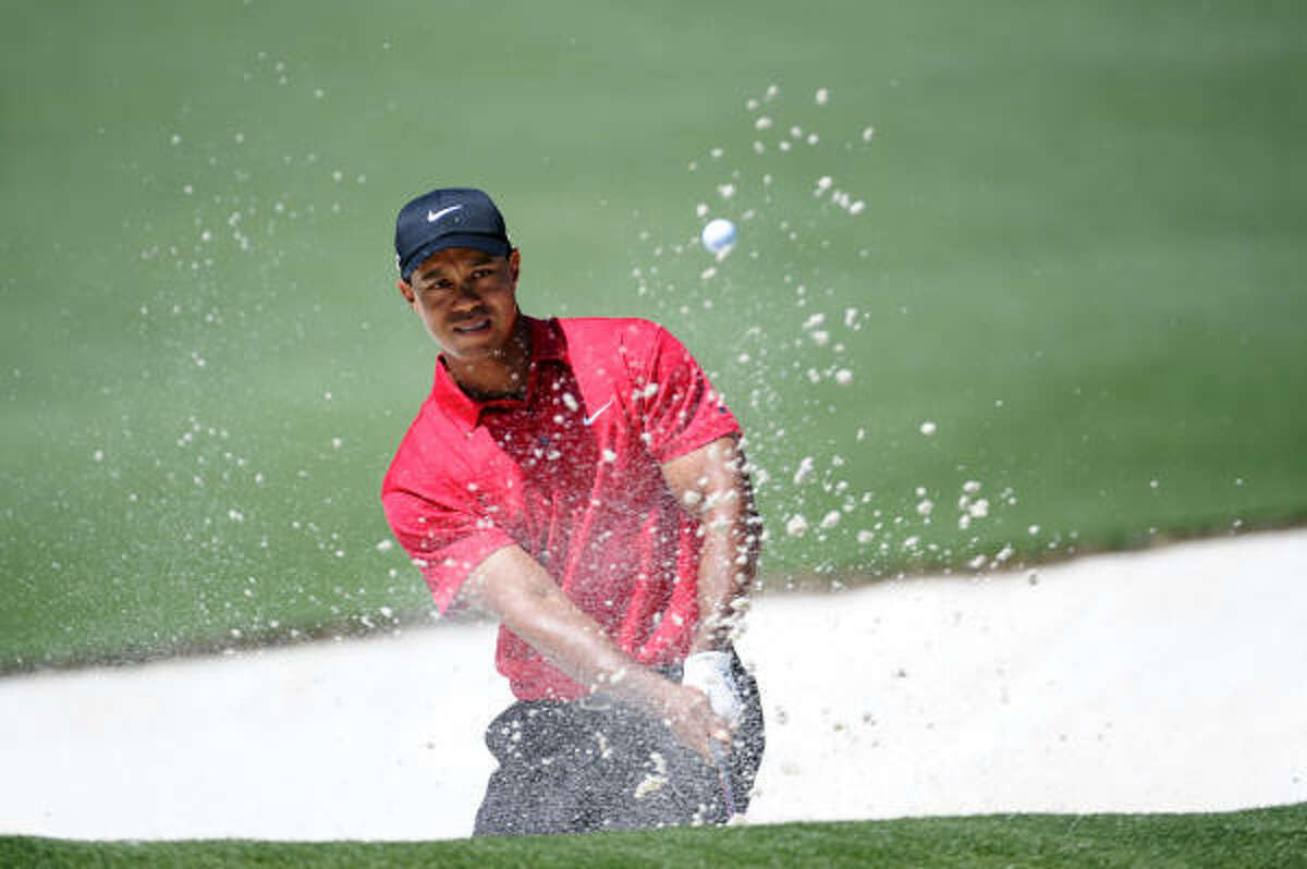 Sunday: Tiger Woods plays a bunker shot on the second hole. Woods bogeyed three of the first five holes during the final round.