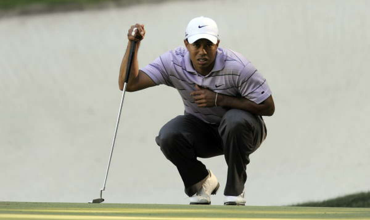 Tiger Woods shot a 2-under 70 during the third round of the Masters on Saturday to finish at 8-under 208, staying within four shots of leader Lee Westwood as they head into Sunday's final round.