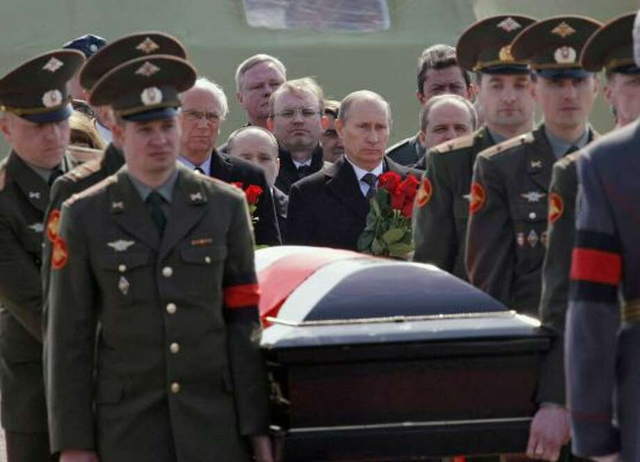 Russian Prime Minister Vladimir Putin, right, and Polish Ambassador to Russia Jerzy Bahr, left, follow the coffin of Polish President Lech Kaczynski carried by Russian militaries during a farewell ceremony at the Smolensk airport on Sunday. Photo: Alexei Nikolsky, AP