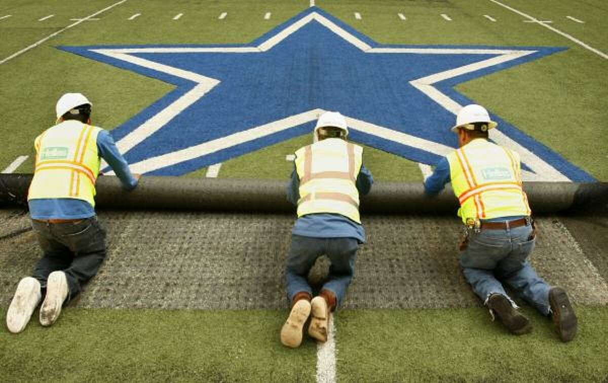 And workers rolled up the Dallas Cowboys star symbol.