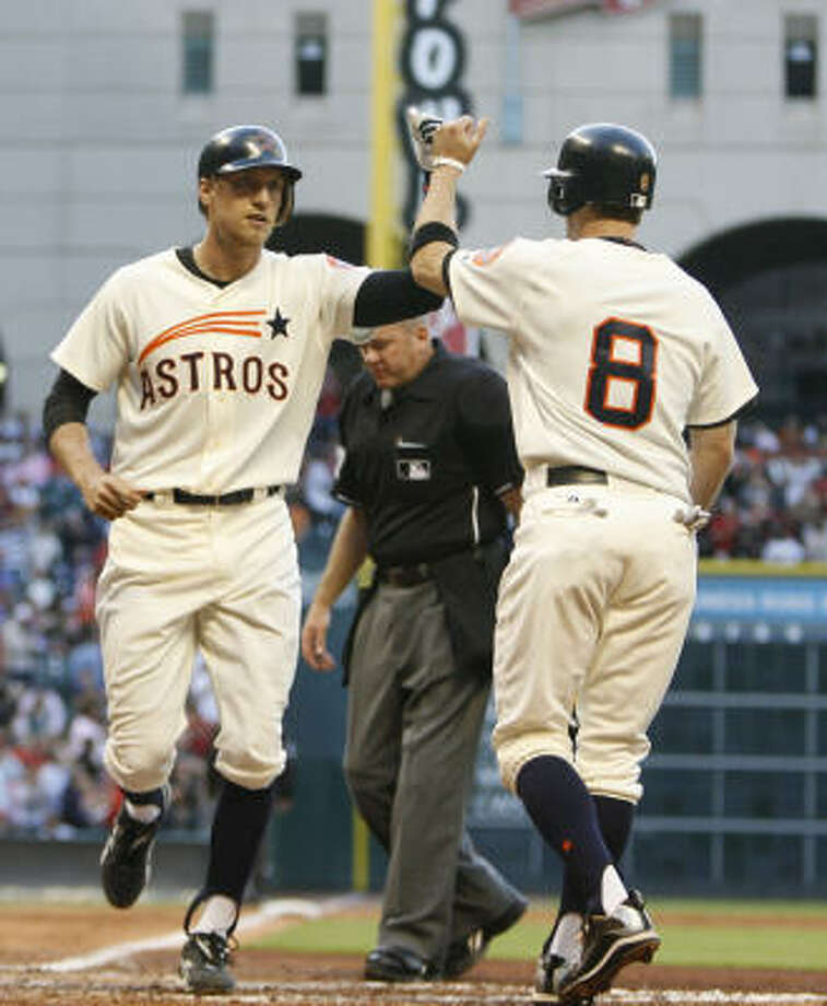 Astros right fielder Hunter Pence and second baseman Jeff Keppinger celebrate Pence's two-run homer in the third inning. Photo: Karen Warren, Chronicle