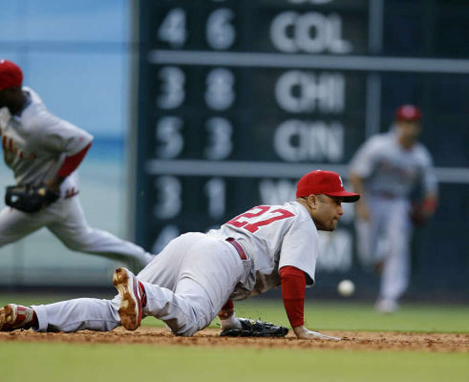 Phillies third baseman Placido Polanco lies on the ground after diving for a ball hit by Astros first baseman Pedro Feliz during the third inning. Photo: Karen Warren, Chronicle