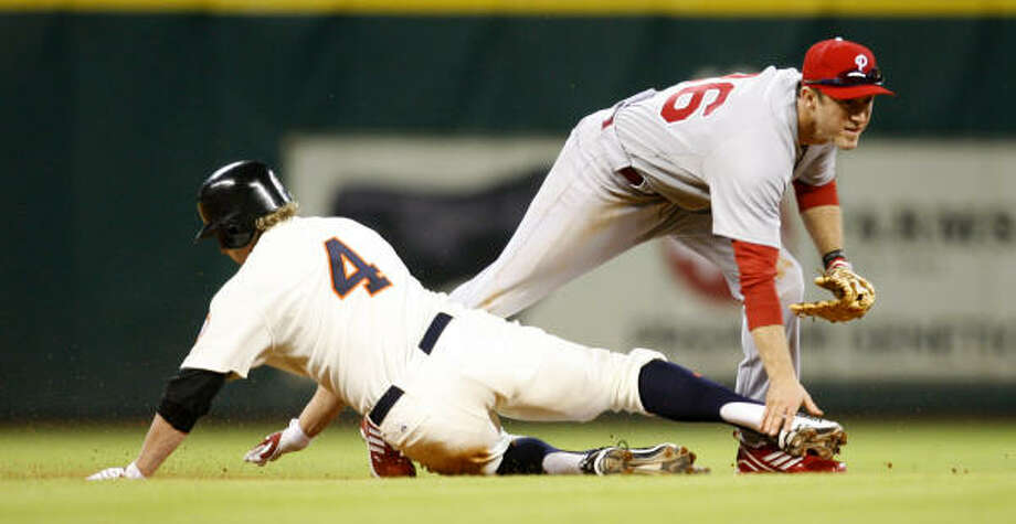Astros center fielder Jason Michaels slides into second under Phillies second baseman Chase Utley, who just missed a double play. Photo: Karen Warren, Chronicle