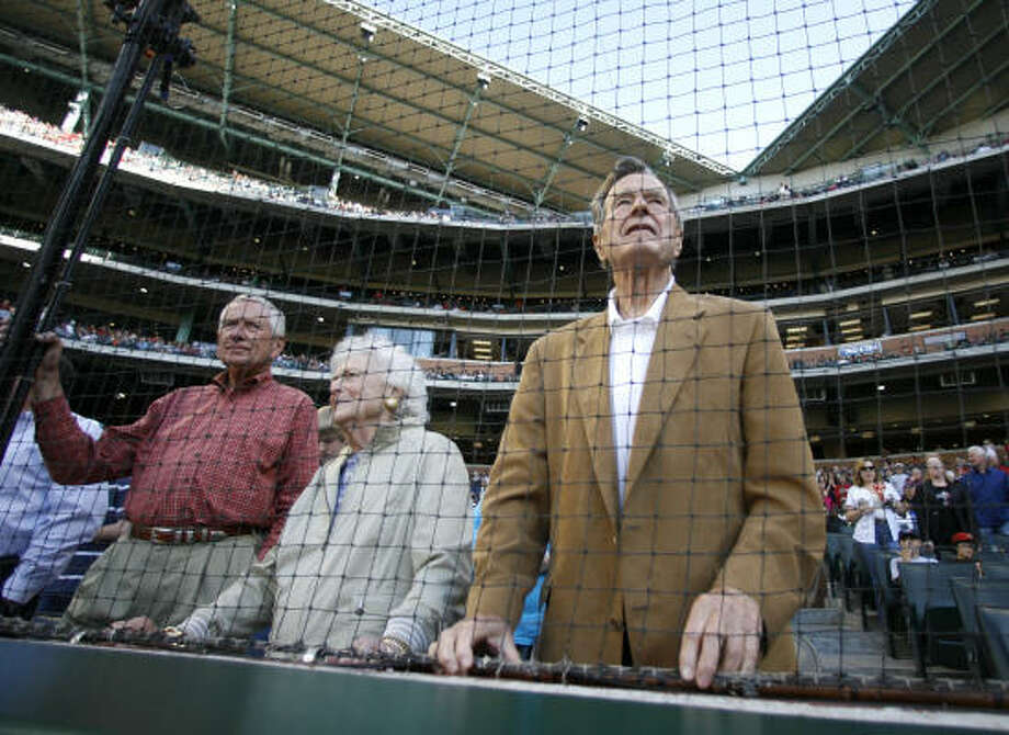 Former President George H. Bush, his wife Barbara and Drayton McLane look to the field before the start of the game. Photo: Karen Warren, Chronicle