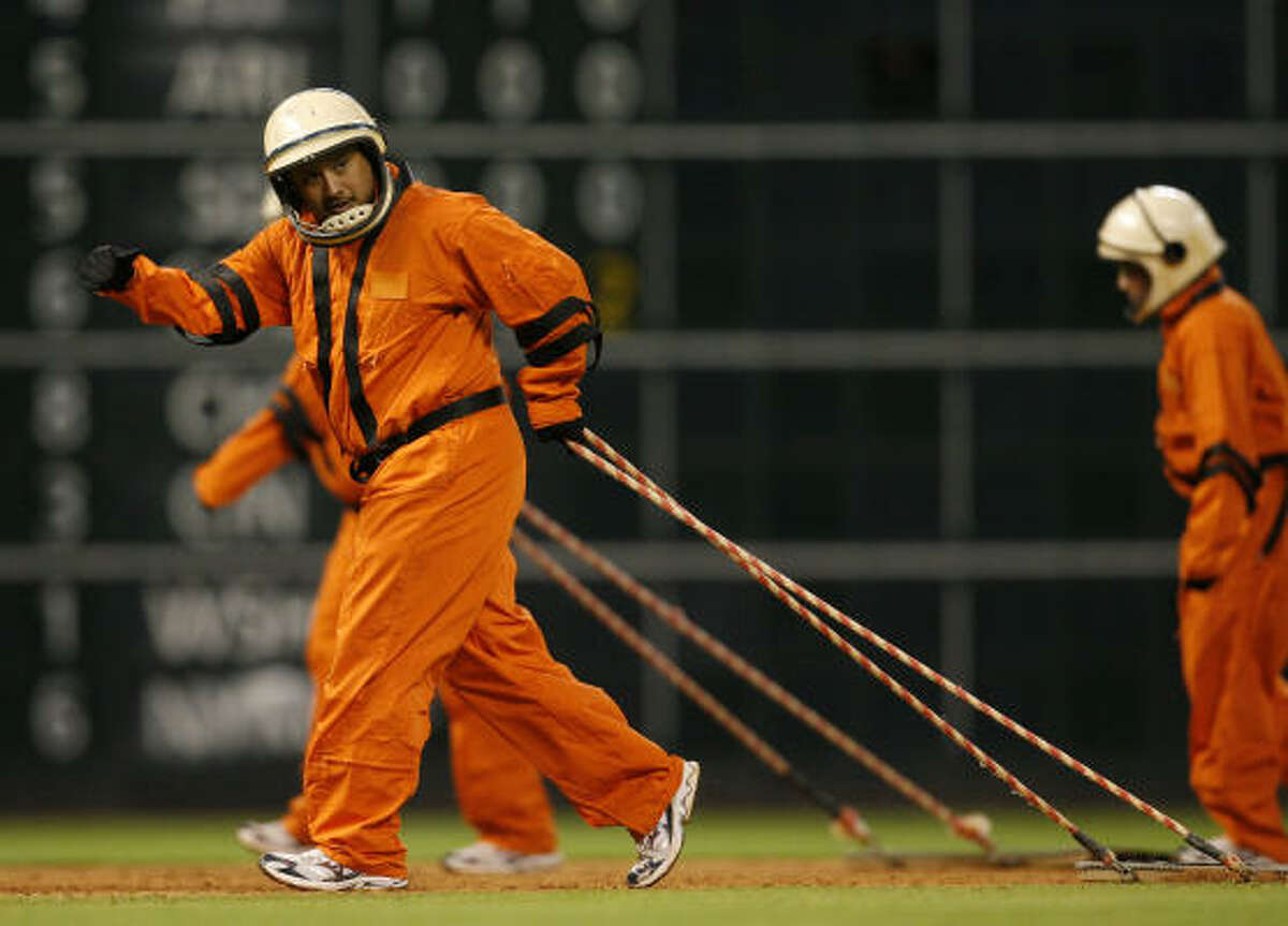 Minute Maid Park Grounds crew, dressed in 1965 uniforms, out on the field between innings during the 7th inning of the Houston Astros Philadelphia Phillies MLB baseball game at Minute Maid Park.