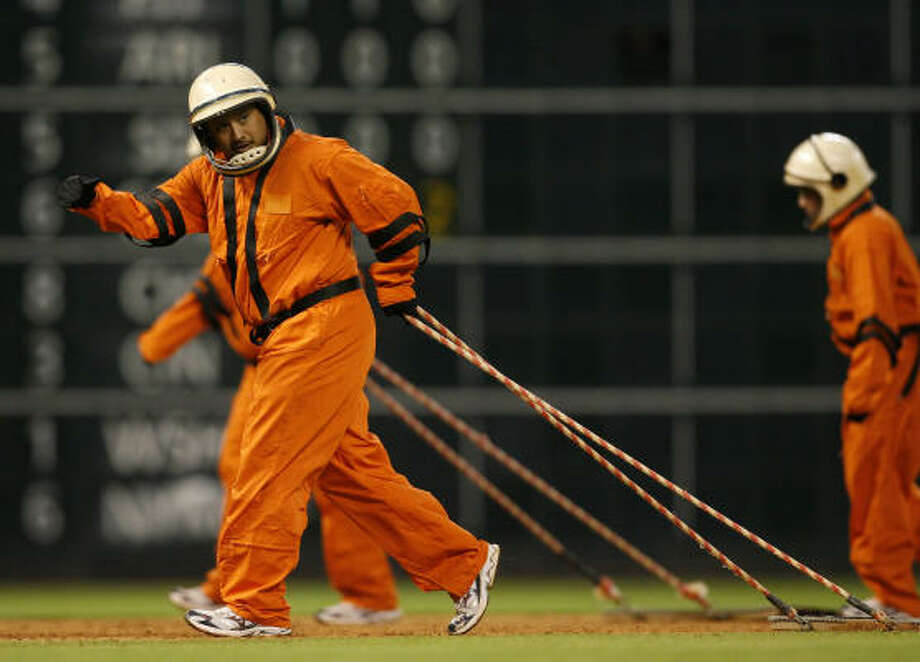 Minute Maid Park Grounds crew, dressed in 1965 uniforms, out on the field between innings during the 7th inning of the Houston Astros Philadelphia Phillies MLB baseball game at Minute Maid Park. Photo: Karen Warren, Chronicle