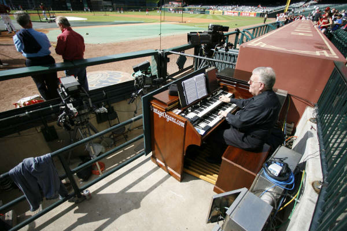 Brian Granquist plays the organ during the Astros