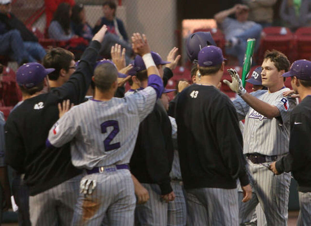 TCU's Jason Coats, right, celebrates after hitting a solo home run off UH reliever Tanner Shiflett in Friday's game at Cougar Field. TCU cruised to a 15-1 win.